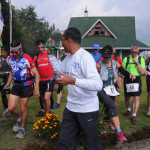 Runners at start of Race day 4 with Race Director