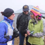 Runner at finish line check point with Race Medical Director