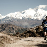 Runner on the trail with Kanchenjunga in the background