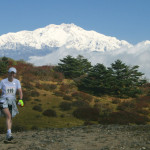 Runner on the trail; Mt. Kanchenjunga in the background
